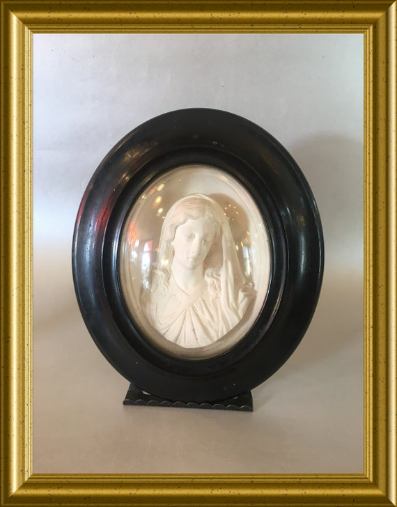 Antique black oval wooden frame: meerschaum, Mary, Madonna, domed glass