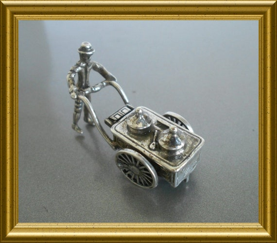 Vintage silver miniature ice-cream man with cart