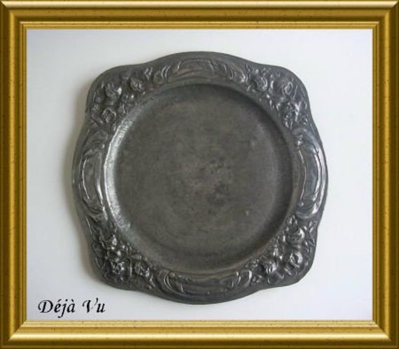 Antique pewter plate with rose decoration
