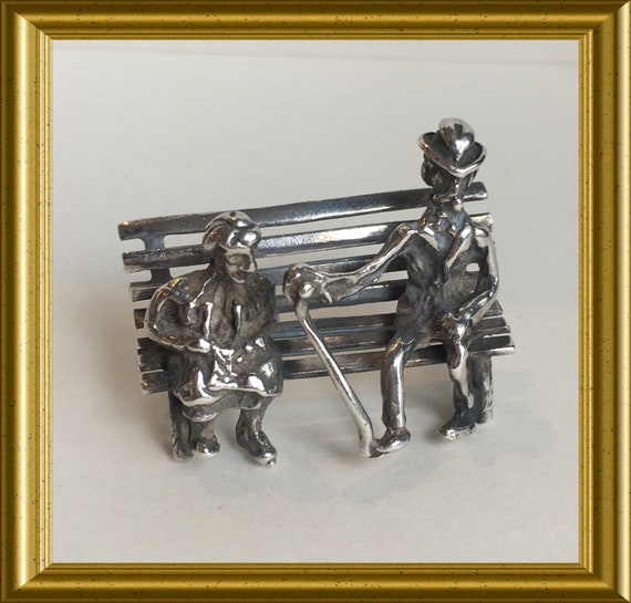 Vintage silver miniature: elderly couple on a bench