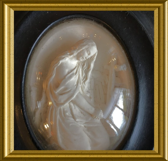 Antique black frame: meerschaum, mourning lady, grave, cross