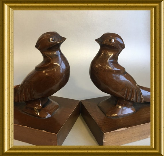 Two art deco wooden birds with glass eyes, bookends