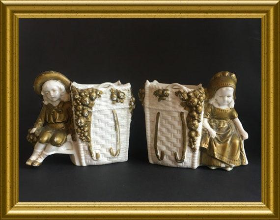 Two antique porcelain figurines/ vases