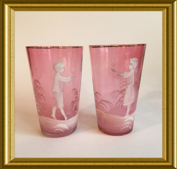 Two antique pink glass beakers, tumblers: Mary Gregory