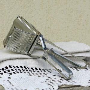 Trivet for hot dishes with handles vintage Western Germany extendable trivet metal coaster casserole cookpot holder
