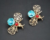 Pair of Antique to Vintage Blue Red Rhinestone Bug Fly Brooches Pins