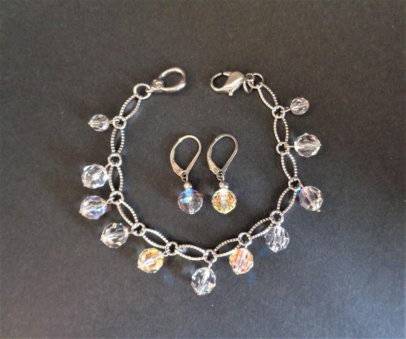 Signed Swarovski Crystal Silver Tone Bracelet and Earrings image 0