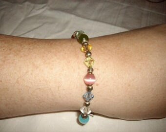 Vintage Silver Tone Multi Color Blue Green Orange Purple Pink Cat's Eye Glass and Resin Bead Cross Charm Toggle Clasp Bracelet 7.5 Inches