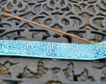 Incense / joss stick holder. Ceramic with blue glaze