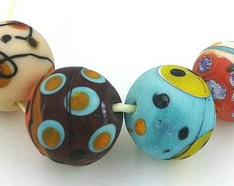 4 handmade hollow glass beads