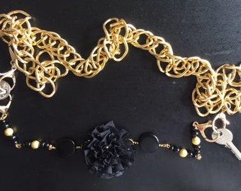 Gold, elegant shabbat with a black flower sash