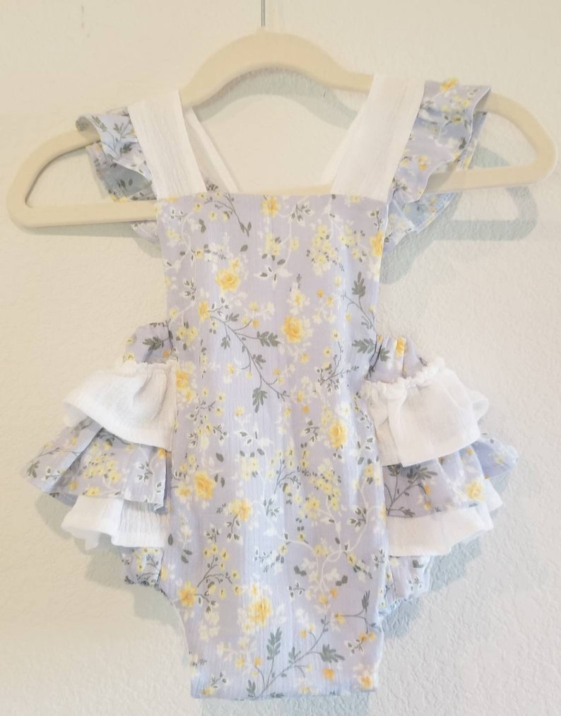 Baby romper with blue spring print and ruffled butt image 0