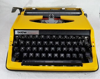 Vintage 1970s working warm yellow BROTHER Deluxe 800  typewriter.   T001