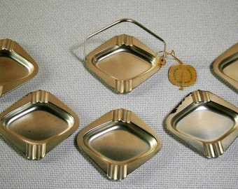 Vintage 6-piece Silver Plated WMF ashtrays in storage rack with label and stamp WMF