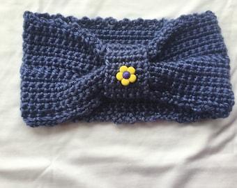 Childrens ear warmer headband with flower button.