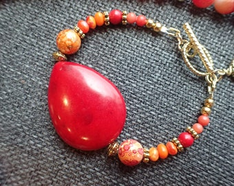 Shades of red and orange beaded bracelet
