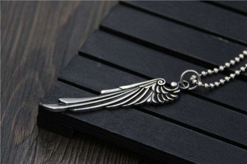 S925 pure silver carved wings pendant