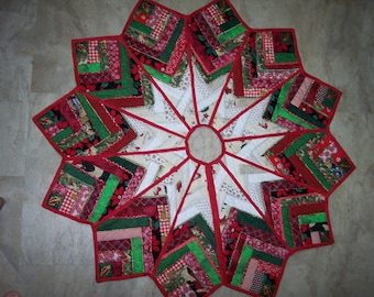 """Dazzling Christmas tree skirt in a 50"""" X 50"""" point to point diameter. Heavily quilted, newly handmade, reversible."""