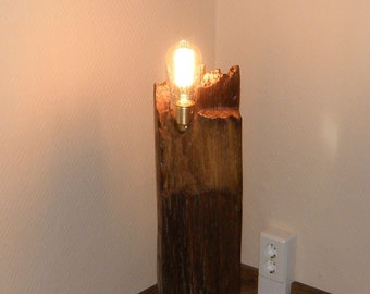 Floor lamp made of solid old wood beam, oak with golden accents and Edisonlampe