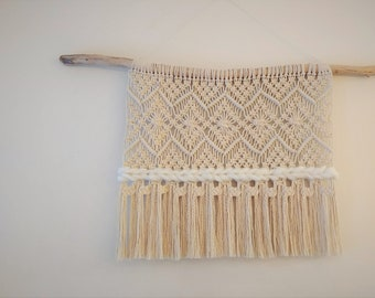 Diamonds in the tuft macrame wall hanging on driftwood