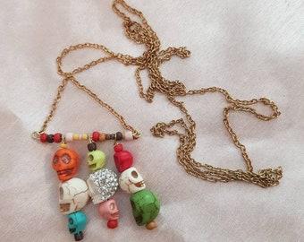 Multi colour hanging skulls necklace