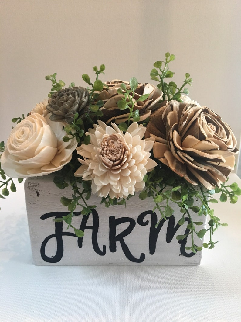 Solo wood flower arrangement