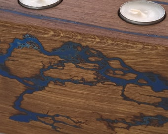 Extravagant tea light holder of solid, old precious wood, recycled wood-glows in the Dark series Thunder
