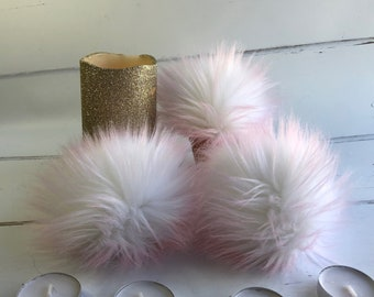 White and pink tipped faux fur pom pom. Detachable option