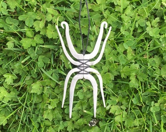 A stainless steel two fork necklace; cutlery jewellery in the shape of a spider