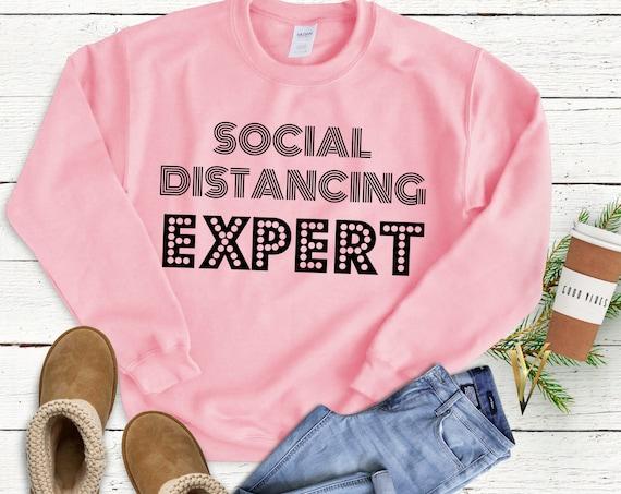 Social Distancing Expert- Popular Comfortable Woman's Crew neck Sweatshirt - Casual Gift for Her, Him, Social Distancing, Introvert Gift