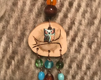 An Owl On A Branch Wooden Pendant