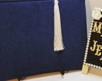Denim clutch bag.