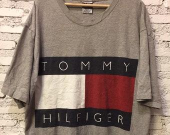 9de1160b5 Vintage Tommy Hilfiger Spell out flag big logo Tee Size XLarge