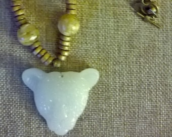 jade leopard head , coconut heishi bead and shell bead necklace