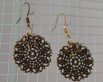 Handmade whimsical star antique looking bronze earrings