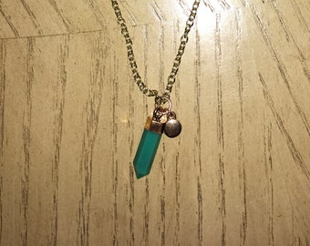 Handmade teal crystal pendant on gold necklace. Also has a moon pendant