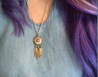 Handmade necklace with dream catcher pendant on gold chain