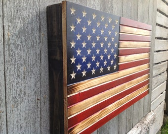 11e01feb08a American Flag Weapon Concealment Cabinet