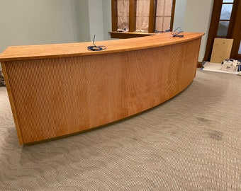 Curved cash wrap reception desk