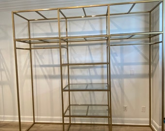Square clothing display rack with glass shelves