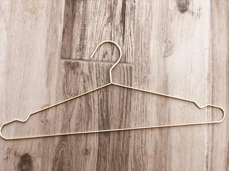 Gold non scratching metal hanger image 0