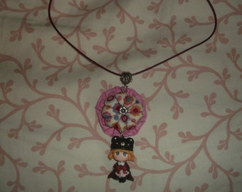 Yoyo Flower necklace and her doll polymer clay