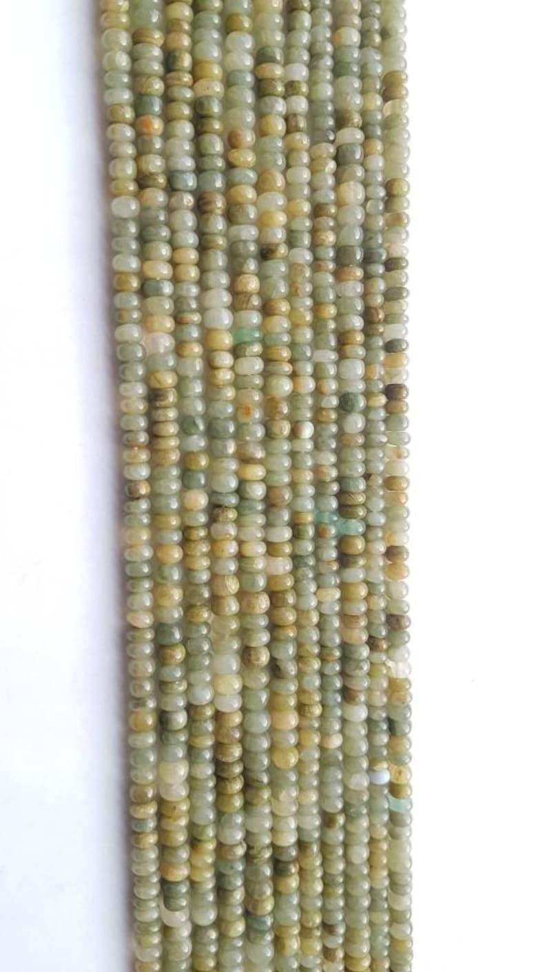 AAA+++1 strand catseye aventurine smooth plain rondelle beadsgolden green catseye aventurine plain beadcatseye beadaventurine bead12.75