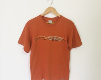 683a5f5f2859 Vintage 90s GUESS Logo Tshirt Graphic Orange Color Size S Made In USA Guess  Georges Marciano Hawaiian Surf Rocky Skaters Old School Shirt