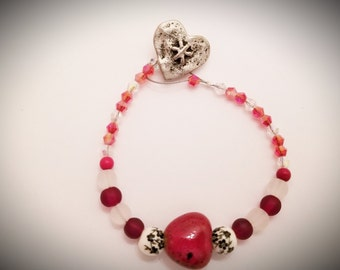Red and white glass beaded bracelet with center heart