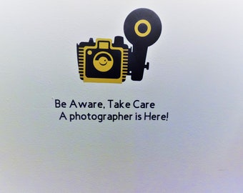 Be Aware of the Photographer