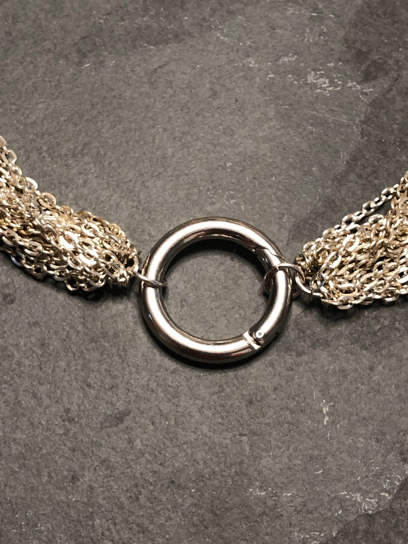 Elegant multi strand day collar with steel ring clasp.