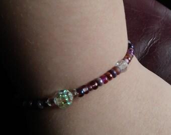 Swarovski crystal and purple bead bracelet