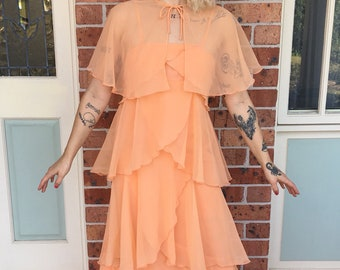 1970s peach chiffon tiered evening / prom / bridesmaid dress with removable cape