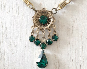 Upcycled flower pendant necklace with emerald green rhinestones and gold-toned vintage chain.